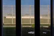 The view of the prison sports pitch from a cell. HMP/YOI Portland, Dorset. A resettlement prison with a capacity for 530 prisoners. Dorset, United Kingdom.