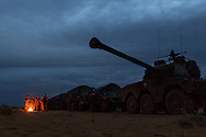 French troops camp in a massive convoy moving through the desert along the Mauritania border in route to Timbuktu on Jan. 28, 2013.