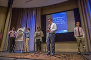 Purchase, NY – 31 October 2014. The team from White Plains High School presenting. (Left to right: Frank Marte,  Matthew Garrison, Alisa  Chaibay,  Ross Van Doron, Robert Lovitch.) White Plains High School went on to take first place in the 2014 competition. The Business Skills Olympics was founded by the African American Men of Westchester, is sponsored and facilitated by Morgan Stanley, and is open to high school teams in Westchester County.