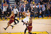 Golden State Warriors guard Stephen Curry (30) lays the ball into the basket against the Cleveland Cavaliers at Oracle Arena in Oakland, Calif., on January 16, 2017. (Stan Olszewski/Special to S.F. Examiner)