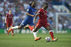Liverpool's Sadio Mane and Chelsea's Victor Moses battle for the ball