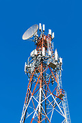 cellular and microwave antennas on a red and white communications tower in Goondiwindi, Queensland, Australia <br />