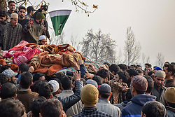 November 20, 2018 - Shopian, Jammu & Kashmir, India - (EDITORS NOTE: Image depicts death.).Kashmiri Muslims are seen carrying the dead body of the slain militant Abid Nazir Wagay during his funeral procession in Paddarpora Shopian..Thousands of Kashmiri Muslims attend the funeral procession of the slain Militant Abid Nazir Wagay at his residence Paddarpora in south Kashmir's Shopian district some 80 Kms from summer capital of Srinagar, Abid was killed along with his three associates in a gunfight with Government forces at Nadigam village Shopian and an Indian trooper also killed during the gunfight. (Credit Image: © Idrees Abbas/SOPA Images via ZUMA Wire)