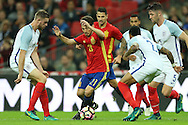 David Silva of Spain looks to go past Jordan Henderson, the England captain (l) and Nathaniel Clyne of England. England v Spain, Football international friendly at Wembley Stadium in London on Tuesday 15th November 2016.<br /> pic by John Patrick Fletcher, Andrew Orchard sports photography.