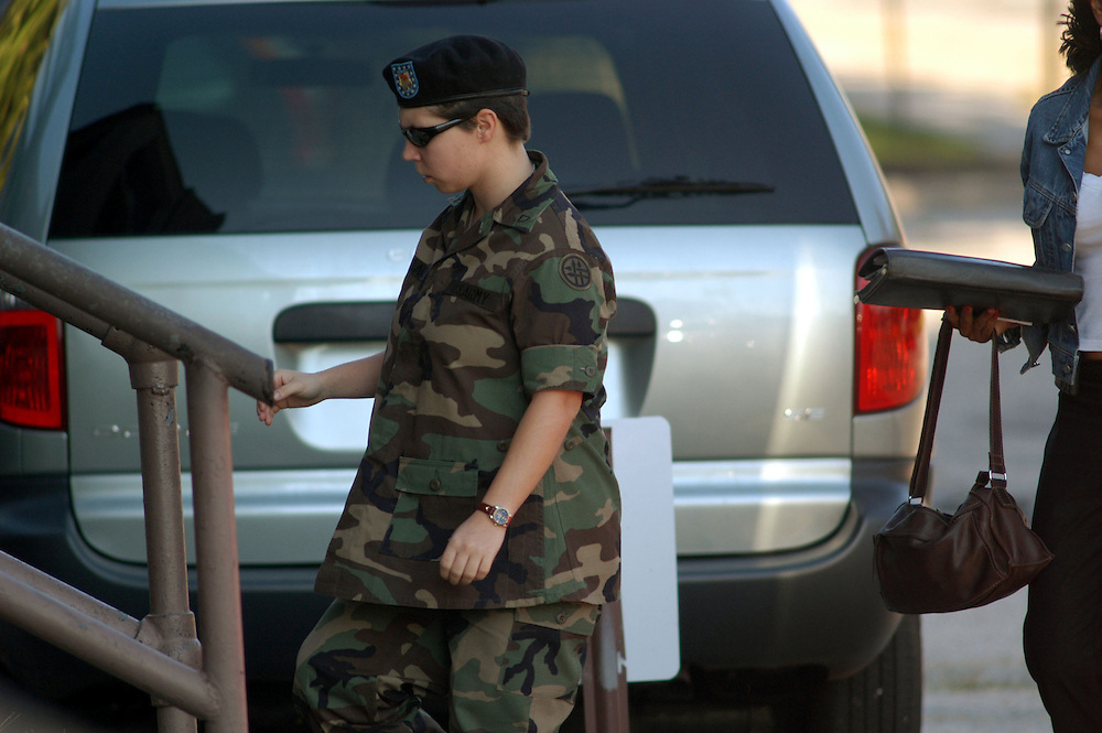 FORT BRAGG, NC- AUGUST 7: Pfc. Lynndie England enters Saturday's hearing at the Staff Judge Advocate Building on Fort Bragg in Fayetteville, NC on 8/7/04 for her Article 32 investigation hearing. The planned events for today include both the defense and prosecution arguing over acceptance of witnesses. The defense has over 160 witness they have asked to bring to the stand. England is charged with several counts, including one specification of conspiring to commit maltreatment of an Iraqi detainee, three specifications of assault against Iraqis, and several others. (Photo by Logan Mock-Bunting)