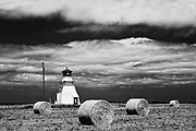 Lighthouse and bales
