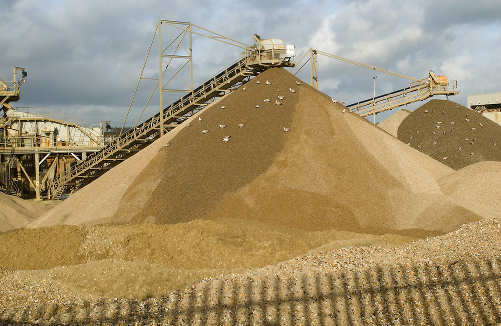 Piles of sand at a depot at Shoreham Port, East Sussex. 2008.