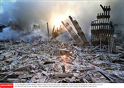 © Jim MacMillan/KRT/ABACA. 28624-3. New York City-NY-USA, 12/09/2001. A New York City firefighter looks at the ruins of the World Trade Center at dawn. Two airplanes were hijacked and flown into both towers of the World Trade Center  | 28624_03