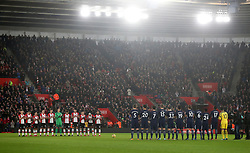 Both teams stand for a minute's applause in memory of the late Cyrille Regis prior to the Premier League match at St Mary's, Southampton.