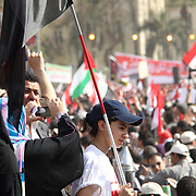 A young woman waves a big Egyptian flag in Cairo's Tahrir Square.