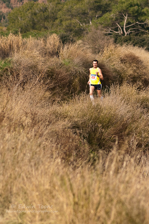 Photos of individuals and group of runners in the Running race of the Festa Major D'Hivern Polinyá.