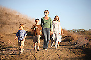 Mom And Kids Hiking In The Hills