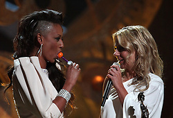 Geri Halliwell (right) and Melanie Brown collect the award for 'Best Brit perforamce of 30 years' on behalf of the Spice Girls during the BRIT Awards 2010, at Earls Court, London.