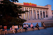 Chinese domestic tourists outside the National Museum. The National Museum of China flanks the eastern side of Tiananmen Square in Beijing, China. The mission of the museum is to educate about the arts and history of China. It is directed by the Ministry of Culture of the People's Republic of China. The museum was established in 2003 by the merging of the two separate museums that had occupied the same building since 1959. The building was completed in 1959 as one of the Ten Great Buildings celebrating the ten-year anniversary of the founding of the People's Republic of China. After four years of renovation, the museum reopened on March 2011 with 28 new exhibition halls, more than triple the previous exhibition space, and state of the art exhibition and storage facilities. It has a total floor space of nearly 200,000 square meters to display. The renovations were designed by the German firm Gerkan, Marg and Partners.