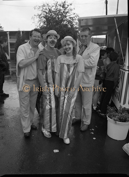 """Guinness Family Day At The Iveagh Gardens. (R83)..1988..02.07.1988..07.02.1988..2nd  July 1988..The family fun day for Guinness employees and their families took place at the Iveagh Gardens today. Top at the bill at the event were """"The Dubliners"""" who treated the crowd to a performance of all their hits. Ireland's penalty hero from Euro 88, Packie Bonner, was on hand to sign autographs for the fans...All smiles despite the rain, organisers of the day pose for pictures."""