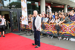 © Licensed to London News Pictures. 24/06/2014. London, UK Louis Walsh, X Factor London Photocall, Emirates Stadium, London UK, 24 June 2014. Photo credit : Richard Goldschmidt/LNP