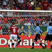 Denmark's Jon Dahl Tomasson's looping header drops towards goal and the winning goal for Denmark