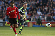 Fraizer Campbell of Cardiff city breaks away from Glenn Whelan of Stoke. Barclays Premier league match, Cardiff city  v Stoke city at the Cardiff city stadium in Cardiff, South Wales on Saturday 19th April 2014. pic by Mark Hawkins, Andrew Orchard sports photography,