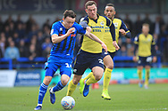 Ollie Rathbone is chased by Harrison McGahey during the EFL Sky Bet League 1 match between Rochdale and Scunthorpe United at Spotland, Rochdale, England on 23 March 2019.