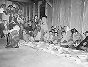 Y-480418-23. Indian children in the Celilo Village longhouse during the Feast of the First Salmon dinner. April 18, 1948.