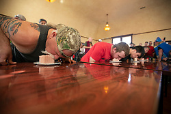 Contestants try to down a 12-ounce loaf of Spam as fast as they can at the 22nd annual Spam Festival, Sunday, Feb. 16, 2019, in Isleton, Calif. Spam lovers competed for prizes by presenting their favorite Spam-infused foods, or entering the Spam-eating and Spam-toss contests. (Photo by D. Ross Cameron)