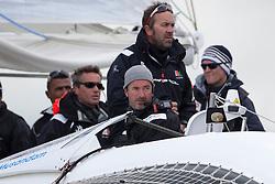 Damian Foxall (IRL) on the helm while Tim Kroger (GER) is on the lookout before the start. Oman Sail's MOD70 Musandam races in the Eckernförde race at  Kiel week 2014, 21-06-2014, Kiel - Germany.