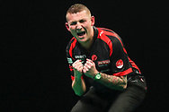 Nathan Aspinall beats Michael van Gerwen and celebrates during the Unibet Premier League darts at Motorpoint Arena, Cardiff, Wales on 20 February 2020.