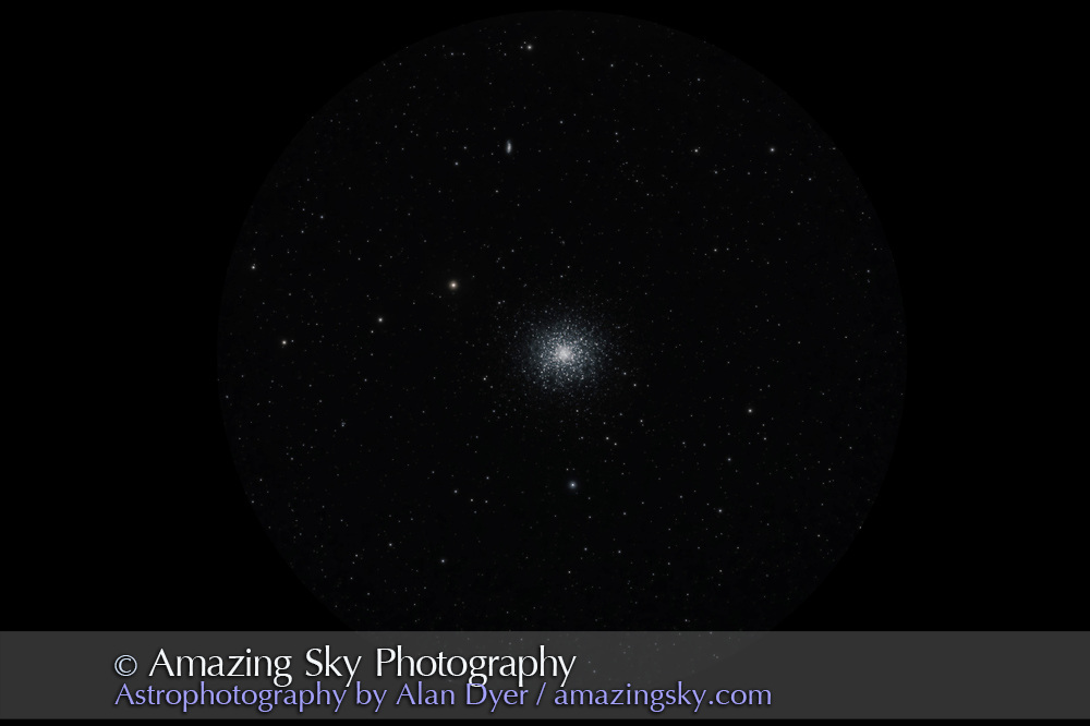 The globular cluster Messier 13 (M13) in Hercules, with the small galaxy NGC 6207 above it. The very tiny galaxy IC 4617 is just visible between NGC 6207 and M13. M13 is generally considered the finest globular cluster in the northern half the sky (north of the celestial equator).<br /> <br /> This is processed to simulate the view through a telescope eyepiece.