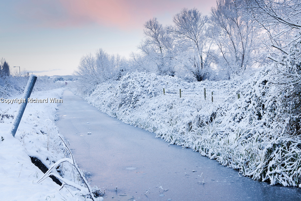 Winter scene of part of Wembdon Rhyne after heavy overnight snow,
