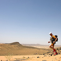 25 March 2007: A participant runs across a blooming desert because of a rainy winter between Irhs and Khermou during the first stage of  the 22nd Marathon des Sables, a 6 days and 151 miles endurance race with food self sufficiency across the Sahara Desert in Morocco. Each participant must carry his, or her, own backpack containing food, sleeping gear and other material.