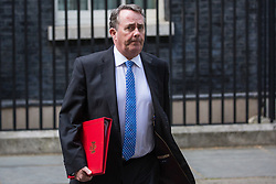 London, UK. 21 May, 2019. International Trade Secretary Liam Fox leaves 10 Downing Street following a mid-afternoon meeting. He left at the same time as Foreign Secretary Jeremy Hunt and Defence Secretary Penny Mordaunt and just before Prime Minister Theresa May left to make a statement on her Brexit Withdrawal Agreement Bill following Cabinet approval earlier in the day.