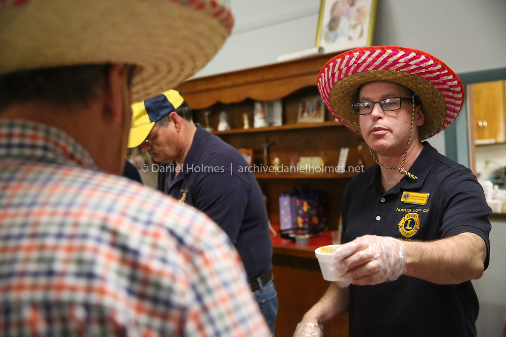 (3/14/15, NORFOLK, MA) Jonathan Garven serves up some chili during the Norfolk Lions' 8th annual Chili Fest at St. Jude's Parish Hall in Norfolk on Saturday. Daily News and Wicked Local Photo/Dan Holmes