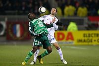 FOOTBALL - FRENCH CHAMPIONSHIP 2009/2010 - L1 - OLYMPIQUE LYONNAIS v ST ETIENNE - 13/03/2010 - PHOTO ERIC BRETAGNON / DPPI - <br />  BAKARY SAKO (ASSE) / ANTHONY REVEILLERE (LYON)