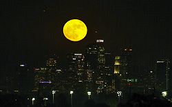 November 14, 2016 - Los Angeles, California, U.S - The full moon rises behind the downtown Los Angeles skyline on Monday, Nov. 14, 2016,  in Los Angeles. The brightest moon in almost 69 years is lighting up the sky in a treat for star watchers around the globe. The phenomenon known as the supermoon reached its peak luminescence in North America before dawn on Monday. Its zenith in Asia and the South Pacific was Monday night. (Credit Image: © Ringo Chiu via ZUMA Wire)