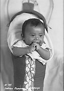9305-B7359.  Indian baby in cradleboard, photographed by the Elite Studio of The Dalles