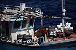 INDIAN OCEAN 24MAR13 - An unidentified Sri Lankan fishing vessel (IMUL-A-0212 CHW) runs at full speed in the Chagos EEZ in the Indian Ocean.<br /> <br /> <br /> <br /> The Greenpeace ship Esperanza is on patrol in the Indian ocean documenting illegal fishing vessels.<br /> <br /> <br /> <br /> jre/Photo by Jiri Rezac / Greenpeace