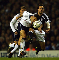Photo. Javier Garcia<br />24/02/2003 Tottenham v Fulham, FA Barclaycard Premiership, White Hart Lane<br />Gus Poyet of Spurs gets in ahead of a leaping Sylvain Legwinski