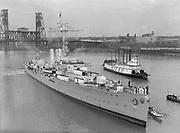 "9969-2269. German training ship ""Emden"" moving in to her berth beside the Burnside Bridge, Portland, Oregon. January 21, 1936."