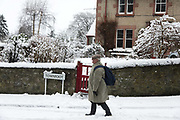 A man walks in fresh snow on 14th of January 2021 in Stow, Scottish Borders, United Kingdom. The first real snow of the year has been falling all night and morning making it hard to get about.