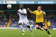 Bury's Pablo Mills (l) and Burton's Stuart Beavon chase the ball. Skybet football league two match, Bury v Burton Albion at the JD Stadium, Gigg Lane in Bury, Lancs on Saturday 20th Sept 2014.<br /> pic by David Richards,  Andrew Orchard sports photography.
