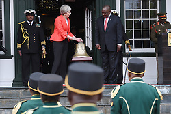 Prime Minister Theresa May gives the bell of the First World War troopship SS Mendi,to South African president Cyril Ramaphosa at DeTuynhuys Presidential Palace in Cape Town where they held bilateral talks. The prime minister is on the first of a two day visit to South Africa and will later travel to Nigeria and Kenya.