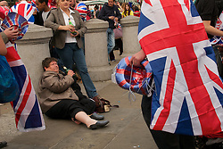 Trafalgar Square, London, UK  29/04/2011. The Royal Wedding of HRH Prince William to Kate Middleton. Revellers festooned with union jack paraphernalia enjoying the party in Trafalgar Square. Photo credit should read PAUL TREACY/LNP. Please see special instructions. © under license to London News Pictures