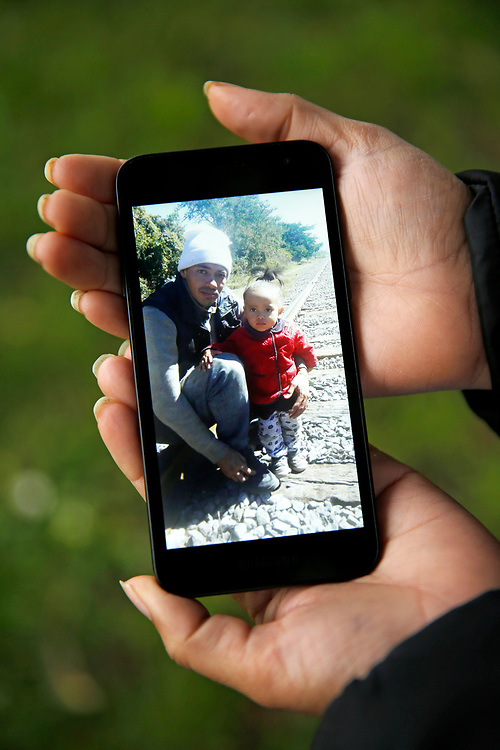 Sindy Flores holds a photo of her husband Kevin Ventura-Corrales and daughter Juliet on Tuesday, Jan. 29, 2019, in San Francisco, Calif. Her one-year-old girl is being held at a Texas shelter. Flores is staying in S.F. with relatives awaiting a claim for asylum.