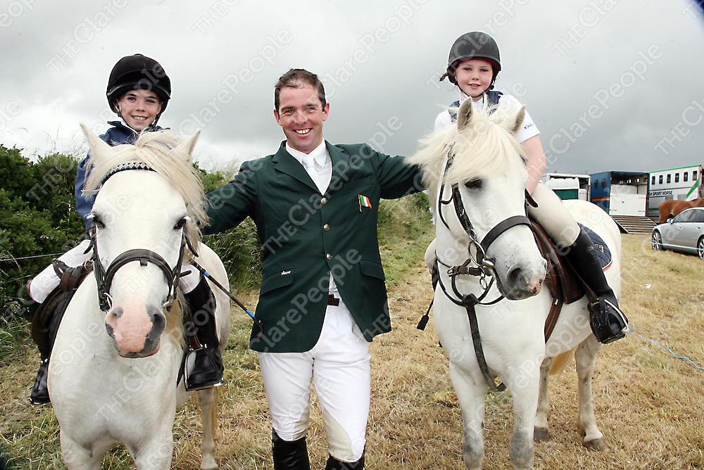 Christopher Slattery and Ashling O' Rourke were delighted to get their picture taken with Cian O' Connor at the annual West Clare Show on Saturday.<br /> <br /> <br /> <br /> Photograph by Yvonne Vaughan.