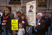Before it erupts into a full-scale riot, families protest against Margaret Thatchers Poll Tax policy, on 31st March 1990, in Trafalgar Square, London, England. Subsequently, angry crowds, demonstrating against Margaret Thatchers local authority tax, stormed the Whitehall area and then Londons West End, setting fire to a construction site and cars, looting stores up Charing Cross Road and St Martins Lane. The anti-poll tax rally in central London erupted into the worst riots seen in the city for a century. Forty-five police officers were among the 113 people injured as well as 20 police horses. 340 people were arrested.
