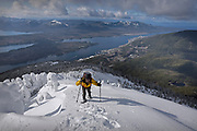 """Ken Arriola ascends past a series of frozen hemlock trees, which he calls """"sentinels,"""" on Saturday, Feb. 29, 2020 near the Deer Mountain summit in Ketchikan, Alaska. The snow depth at second lookout was 6 feet and the snow depth at the summit was over 8 feet."""