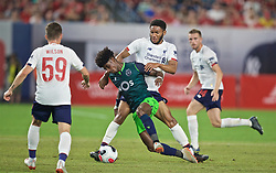 NEW YORK, NEW YORK, USA - Wednesday, July 24, 2019: Liverpool's Joe Gomez (R) and Sporting CF's Thierry Correia during a friendly match between Liverpool FC and Sporting Clube de Portugal at the Yankee Stadium on day nine of the club's pre-season tour of America. (Pic by David Rawcliffe/Propaganda)