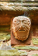 Norman Romanesque exterior corbel no 88 - sculpture of a male with curly hair and theatrical style mouth. The Norman Romanesque Church of St Mary and St David, Kilpeck Herefordshire, England. Built around 1140 .<br /> <br /> Visit our MEDIEVAL PHOTO COLLECTIONS for more   photos  to download or buy as prints https://funkystock.photoshelter.com/gallery-collection/Medieval-Middle-Ages-Historic-Places-Arcaeological-Sites-Pictures-Images-of/C0000B5ZA54_WD0s