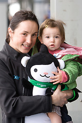 Slovenian biathlon athlete Dijana Ravnikar with her daughter Mija and official mascott at arrival to Airport Joze Pucnik from Vancouver after Winter Olympic games 2010, on February 26, 2010 in Brnik, Slovenia. (Photo by Vid Ponikvar / Sportida)