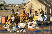 The Aboubakar family of Darfur province, Sudan, in front of their tent in the Breidjing Refugee Camp, in eastern Chad, with a week's worth of food. D'jimia Ishakh Souleymane, 40, holds her daughter Hawa, 2; the other children are (left to right) Acha, 12, Mariam, 5, Youssouf, 8, and Abdel Kerim, 16. From the book Hungry Planet: What the World Eats (Model Released)